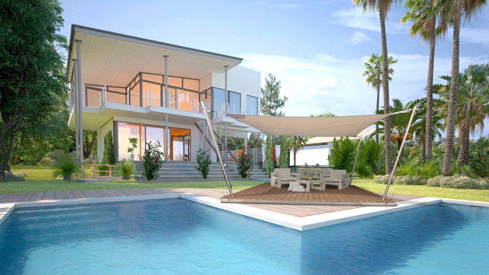 Eine Sonnensegel-Lounge aufgebaut vor einem Pool.