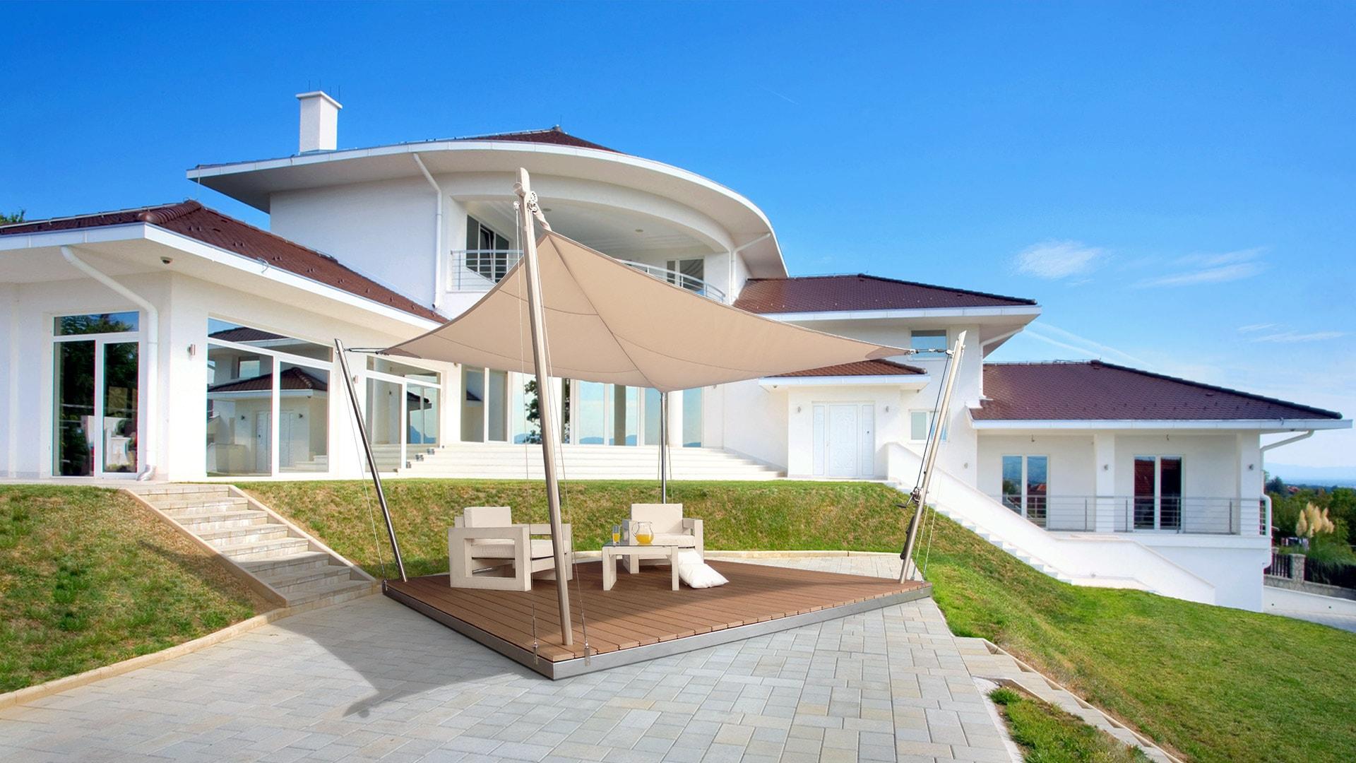 Die Vela-Lounge-Terrasse vor einer Villa aufgestellt.
